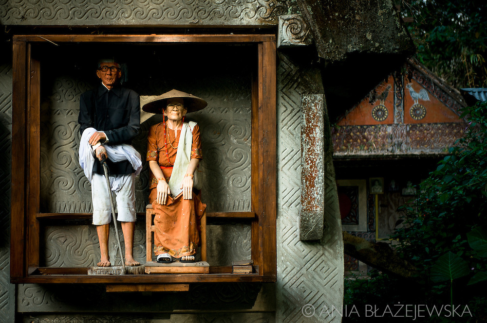 Indonesia, Sulawesi, Tana Toraja. Tau Tau.<br /> <br /> Tana Toraja, situated in the south of Sulawesi, sometimes reminds alive museum full of traditional boat-shaped houses painted with Torajan patterns, burial caves or hanging graves guarded by tau tau (a deceased shaped wooden sculptures(, all of them situated in a beautiful scenery of green rice terraces.