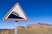 A road sign indicates a steep incline in the Central High Atlas Mountains, Morocco.