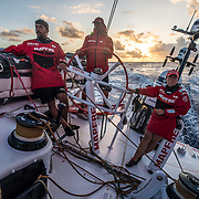 Leg 4, Melbourne to Hong Kong, day 15 on board MAPFRE, Guillermo Altadill, Rob Greenhalgh and Tamara Echegoyen during the sunrise . Photo by Ugo Fonolla/Volvo Ocean Race. 15 January, 2018.