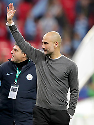 Manchester City manager Pep Guardiola salutes the fans after his side win the Carabao Cup Final in a penalty shoot out