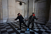 Activists play ball and juggle a diabolo on the 11th day of the Occupy London protest camp in St Paul's cathedral churchyard, London 26/11/11. City lawyers are using medieval pedestrian bylaws to gain a court injunction to evict the activists who set up tents and shelters as in other countries.