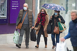 ©Licensed to London News Pictures 13/10/2020  <br /> Bromley, UK. Shoppers wearing protective face masks getting wet in the rain. Autumnal wet weather this afternoon for shoppers in Bromley High Street, Bromley, South East London. Photo credit:Grant Falvey/LNP