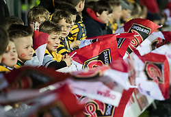 Dragons fans wave their flags<br /> <br /> Photographer Simon King/Replay Images<br /> <br /> Guinness Pro14 Round 12 - Dragons v Cardiff Blues - Sunday 31st December 2017 - Rodney Parade - Newport<br /> <br /> World Copyright © 2017 Replay Images. All rights reserved. info@replayimages.co.uk - http://replayimages.co.uk