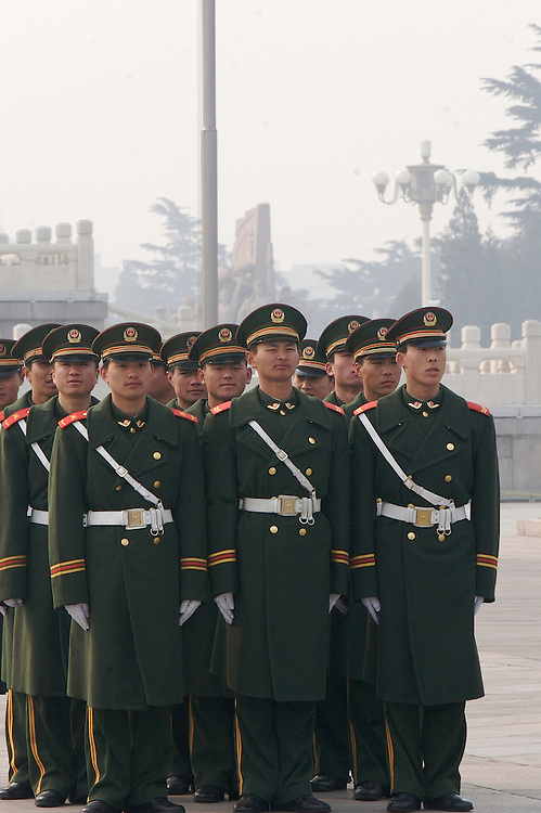 Soldiers at Tiananmen Square gather before the rotation of the guard in Beijing, China.