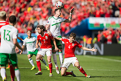 PARIS, FRANCE - Saturday, June 25, 2016: Wales Joe Allen and Ben Davies in action against Northern Ireland's Kyle Lafferty during the Round of 16 UEFA Euro 2016 Championship match at the Parc des Princes. (Pic by Paul Greenwood/Propaganda)