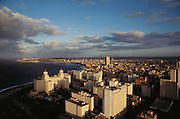 The old section of Havana, Cuba (called Old Havana). The district along the harbor is called the Malecon. The Hotel Nacional is the large structure to the left near the beach (with two cupolas). Material World Project.