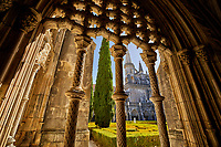 Looking through the ornate archways of the Royal Cloister onto the courtyard of the Monastery of Santa Maria in Batalha, Portugal