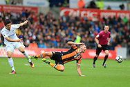 David Meyler of Hull city is fouled by Ki Sung-Yueng of Swansea city. Premier league match, Swansea city v Hull city at the Liberty Stadium in Swansea, South Wales on Saturday 20th August 2016.<br /> pic by Andrew Orchard, Andrew Orchard sports photography.