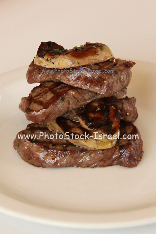 assortment of Beef cuts  grilled on a charcoal barbecue