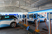BYD Co. E6 electric taxi seen charging at a charging station in Taiyuan, Shanxi province, China, on Tuesday, Sept. 13, 2016. Taiyuan became the first city to replace its entire fleet of taxis with electric vehicles.