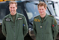 SHREWSBURY, UK: Prince William and Prince Harry and their Instructor at a photocall at RAF Shawbury Defence Helicopter Flying School on the 18th June 2009.<br /> PHOTOGRAPH BY JAMES WHATLING