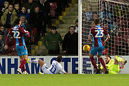 Wycombe Wanderers midfielder Scott Kashket (11) heads the ball on goal which is saved by Scunthorpe United goalkeeper Jak Alnwick (25) during the EFL Sky Bet League 1 match between Scunthorpe United and Wycombe Wanderers at Glanford Park, Scunthorpe, England on 29 December 2018.
