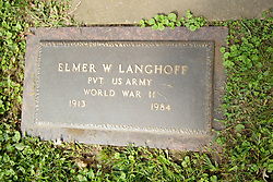 26 August 2017:   A part of the History of McLean County Illinois.<br /> <br /> Tombstones in Evergreen Memorial Cemetery.  Civic leaders, soldiers, and other prominent people are featured.<br /> <br /> Section 16 - Veterans Section<br /> Elmer W Langhoff<br /> Private US Army<br /> 1913  1984