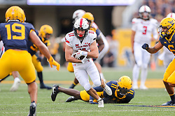 Oct 2, 2021; Morgantown, West Virginia, USA; Texas Tech Red Raiders wide receiver McLane Mannix (11) makes a catch and runs for extra yards during the second quarter against the West Virginia Mountaineers at Mountaineer Field at Milan Puskar Stadium. Mandatory Credit: Ben Queen-USA TODAY Sports