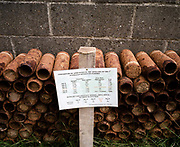 Unearthed and rusting WW1 shells from the Somme battlefield, piled up at Le Tommy Bar, Pozieres, France. On a sign in front, we see the statistics showing the amount of ordnance launched by an Australian artillery division during the notorious 1916 offensive. The Battle of the Somme was a battle of the First World War fought by the armies of the British and French empires against the German Empire. It took place between 1 July and 18 November 1916 on either side of the River Somme in France. The battle was one of the largest of World War I, in which more than 1,000,000 men were wounded or killed, making it one of humanity's bloodiest battles.