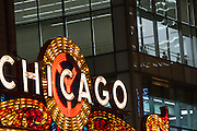 Neon sign at Chicago Theatre with dancers from the Joffrey Ballet practicing in Chicago USA