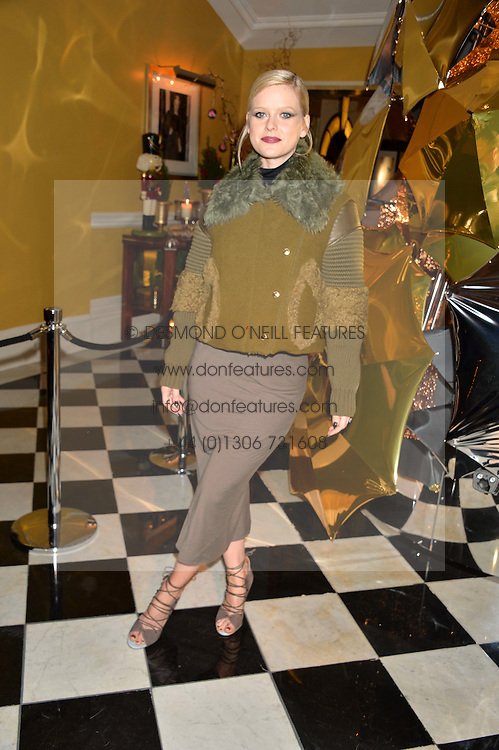 ALICE EVE at a party to celebrate theunveiling of the Claridge's Christmas Tree designed by Christopher Bailey for Burberryheld at Claridge's, Brook Street, London on 18th November 2015.