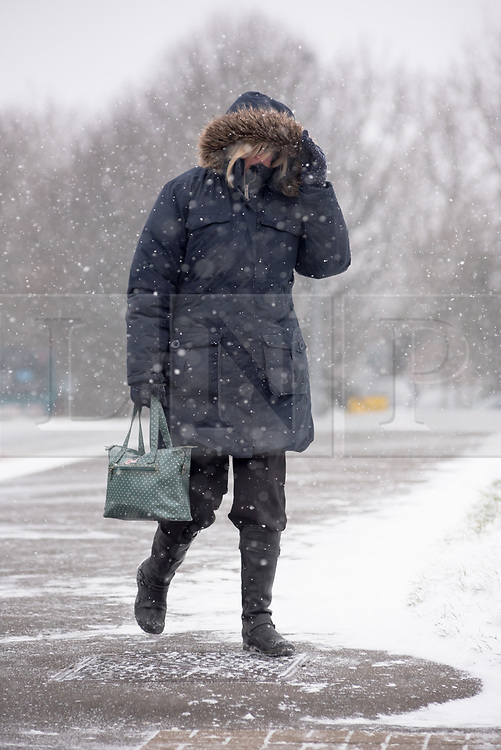 © Licensed to London News Pictures. 01/03/2018. Cardiff, UK.  Shoppers and workers make their way in biting wind and snow. Steady snow is giving way to blizzard conditions with the prospect of snowed in carriageways as Storm Emma begins to bite. Some drivers don't appear to be heeding warnings.   Photo credit: IAN HOMER/LNP