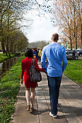 Tall/small. Primary colour couple arriving at the Keukenhof tulip and flower show in Lisse, Holland - Netherlands Editorial Use only.