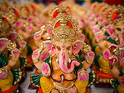 31 AUGUST 2014 - SARIKA, NAKHON NAYOK, THAILAND: Statues of Ganesh at Shri Utthayan Ganesha Temple in Sarika, Nakhon Nayok. Ganesh Chaturthi, also known as Vinayaka Chaturthi, is a Hindu festival dedicated to Lord Ganesh. It is a 10-day festival marking the birthday of Ganesh, who is widely worshiped for his auspicious beginnings. Ganesh is the patron of arts and sciences, the deity of intellect and wisdom -- identified by his elephant head. The holiday is celebrated for 10 days, in 2014, most Hindu temples will submerge their Ganesh shrines and deities on September 7. Wat Utthaya Ganesh in Nakhon Nayok province, is a Buddhist temple that venerates Ganesh, who is popular with Thai Buddhists. The temple draws both Buddhists and Hindus and celebrates the Ganesh holiday a week ahead of most other places.    PHOTO BY JACK KURTZ