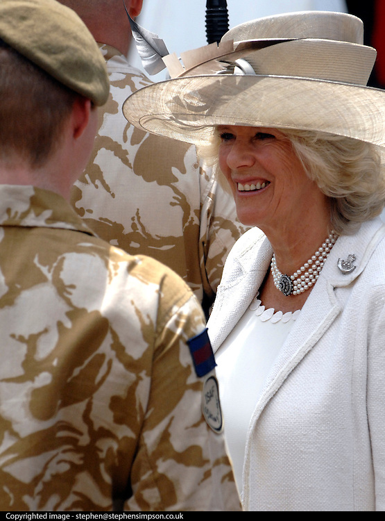 UNITED KINGDOM-WINCHESTER. A sea of public support for 650 troops welcome home parade. Crowds 30 deep and HRH The Duchess of Cornwall welcomed home 11 Light Brigade in Winchester today. The troops marched in sweltering temperatures along a 2 mile route before coming to a halt in front of the city's Guildhall. HRH The Duchess of Cornwall addressed the troops before carrying out an inspection. Two tornado jets completed the parade with a flypast along the main High Street.23/06/2010. (STEPHEN SIMPSON)
