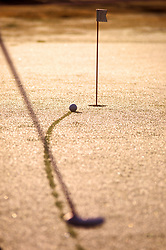 Stock photo of a putt shot on its way to the hole
