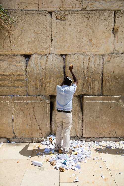A worker removes notes containing prayers and messages which were left by visitors, from the cracks between the stones of the Western Wall, Judaism's holiest prayer site, in the Old City of Jerusalem, Israel, on September 17, 2017. The clean-up which takes place ahead of the upcoming Jewish New Year Holiday, clears the wall's crevices and frees up space for more notes that people of all faiths slip between its stones, believing that requests deposited at the site are more likely to be heard by God.
