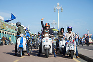Mod scooterist gives the signal to go during the Brighton & Hove Albion Football Club Promotion Parade at Brighton Seafront, Brighton, East Sussex. United Kingdom on 14 May 2017. Photo by Ellie Hoad.