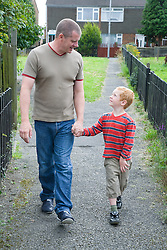 Father and son walking down the street together,