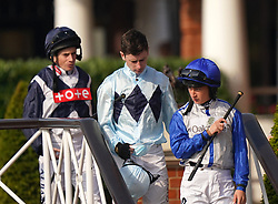 Ryan Moore, Oisin Murphy and Nicola Currie make their way to the Dubai Nursery Handicap at Newmarket Racecourse. Picture date: Saturday October 9, 2021.