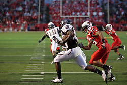 25 September 2010:  Chris Douglas makes his way to the left side with Brandon Westphal giving chase.  The Missouri State Bears lost to the Illinois State Redbirds 44-41 in double overtime, meeting at Hancock Stadium on the campus of Illinois State University in Normal Illinois.