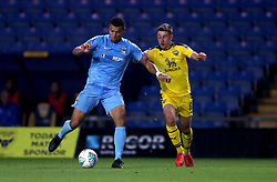 Coventry City's Maxime Biamou (left) and Oxford United's Cameron Brannagan (right) battle for the ball