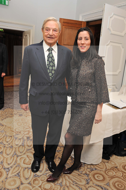GEORGE SOROS and his fiance TAMIKO BOLTON at the 4th Fortune Forum Summit held at The Dorchester Hotel, Park Lane, London on 4th December 2012.