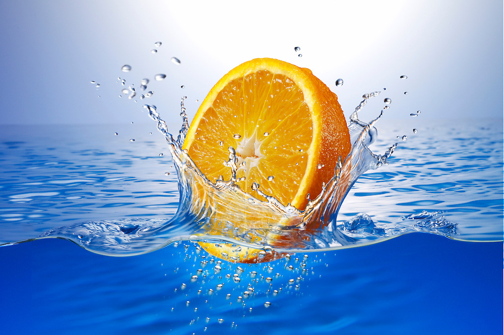 Orange half splashing into water Ray Massey is an established, award winning, UK professional  photographer, shooting creative advertising and editorial images from his stunning studio in a converted church in Camden Town, London NW1. Ray Massey specialises in drinks and liquids, still life and hands, product, gymnastics, special effects (sfx) and location photography. He is particularly known for dynamic high speed action shots of pours, bubbles, splashes and explosions in beers, champagnes, sodas, cocktails and beverages of all descriptions, as well as perfumes, paint, ink, water – even ice! Ray Massey works throughout the world with advertising agencies, designers, design groups, PR companies and directly with clients. He regularly manages the entire creative process, including post-production composition, manipulation and retouching, working with his team of retouchers to produce final images ready for publication.