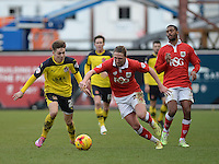 Fleetwood Town's Nick Haughton vies for possession with Bristol City's Luke Ayling<br /> <br /> Photographer Ashley Crowden/CameraSport<br /> <br /> Football - The Football League Sky Bet League One - Bristol City v Fleetwood Town - Sunday 1st February 2015 - Ashton Gate - Bristol<br /> <br /> © CameraSport - 43 Linden Ave. Countesthorpe. Leicester. England. LE8 5PG - Tel: +44 (0) 116 277 4147 - admin@camerasport.com - www.camerasport.com