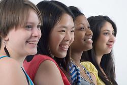 Studio portrait of a teenage girls smiling,