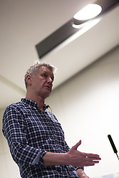 """© Licensed to London News Pictures . 05/03/2013 . Manchester , UK . Former Chief Probation Officer and University of Manchester lecturer , STEVE COLLETT , delivers a lecture at the University of Manchester in which he argues that there a """" real danger """" of a repeat of the riots in England of August 2011 . Mr Collett argued that the circumstances were such that it'd only take another single incident, such as the arrest that sparked the riots in Liverpool in 1981 or the response to the shooting of Mark Duggan that sparked the Tottenham riots in August 2011 , for similar unrest to occur again . He also criticised the government's proposed shake up of the probation services . Photo credit : Joel Goodman/LNP"""