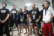 """Fighters pre-fight briefing backstage. Russian Vitaly Bigdash, Top middleweight champion (LHS), centre Florian Garel, Zendokai Karate Champion, Irina Mazepa, 5X Wushu World Champion (RHS)<br /><br />MMA. Mixed Martial Arts """"Tigers of Asia"""" cage fighting competition. Top professional male and female fighters from across Asia, Russia, Australia, Malaysia, Japan and the Philippines come together to fight. This tournament takes place in front of a ten thousand strong crowd of supporters in Pelaing Stadium. Kuala Lumpur, Malaysia. October 2015"""