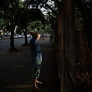 May 09, 2013 - Yangon, Myanmar: A local resident exercises in the early hours of the day, facing a fenced garden in central Yangon. CREDIT: Paulo Nunes dos Santos