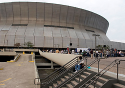 01 January, 2006. New Orleans, Louisiana. Post Katrina aftermath.<br /> New Year's Day in New Orleans, Louisiana. Louisiana Rebirth interfaith service at the Superdome rings out the old disastrous 2005 and rings in what politicians and locals hope will be a successful 2006. Once the scene of so much misery, a mother changes her child's diapers on the steps behind the service.<br /> Photo; ©Charlie Varley/varleypix.com