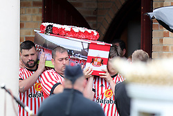 The coffin of Bradley Lowery leaves St Joseph's Church in Blackhall, County Durham following the funeral the six-year-old football mascot whose cancer battle captured hearts around the world, took place.