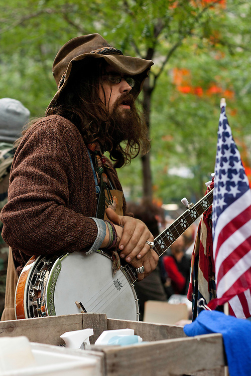 Protester taking a break from playing Banjo during a Occupy Wall Street demonstration in Zuccotti Park. October 21, 2011.
