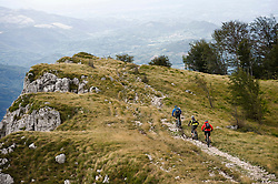 three mountain bikers on the way, Vipava valley, Istria, Nanos, Slovenia