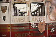 Detail of a destroyed emergency response vehicle that is part of a collection of artifacts saved from the site of the World Trade Center after 9/11. Artifacts chosen by curators out of the wreckage  from the World Trade Center  temporarily stored within an 80,000 square foot hanger at JFK airport. Some of the artifacts will be in the National September 11 Memorial Museum set to open in 2012.