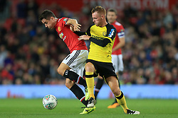 20th September 2017 - Carabao Cup (3rd Round) - Manchester United v Burton Albion - Ander Herrera of Man Utd battles with Tom Naylor of Burton - Photo: Simon Stacpoole / Offside.