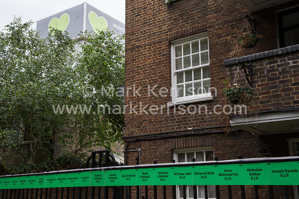 London, UK. 13 June, 2019. Signs bearing the names of those who died in the Grenfell Tower fire in front of the Grenfell Tower in North Kensington. Tomorrow, the Grenfell community will mark the second anniversary of the Grenfell Tower fire on 14th June 2017 in which 72 people died and over 70 were injured. Two years on, some family members remain in temporary accommodation and many are still traumatised. Phase 2 of the Grenfell Inquiry will begin in 2020, with criminal investigation findings expected to be sent to the Crown Prosecution Service in 2021.