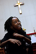 Jeffrey Jr., 7, member of the Hip Hop Church Choir, is dancing in front of the altar at the beat of the music during a Mass Service at the Hip Hop Church in Harlem, New York, NY., on Thursday, June 22, 2006. A new growing phenomenon in the United States, and in particular in its most multiethnic city, New York, the Hip Hop Church is the meeting point between Hip Hop and Christianity, a place where ëGodí is worshipped not according to religious dogmatisms and rules, but where the ëHoly Spirití is celebrated by the community through young, unique, passionate Hip Hop lyrics. Its mission is to present the Christian Gospel in a setting that appeals to both, those individuals who are confessed Christians, as well as those who are not regularly attending traditional Services, while helping many youngsters from underprivileged neighbourhoods to feel part of a community, to make them feel loved and to help them not to give up when problems arise. The Hip Hop Church is not only forward-thinking but it also has an important impact where life at times can be difficult and deceiving, and where young people can be easily influenced for the worst purposes. At the Hip Hop Church, members are encouraged to sing, dance and express themselves in any way that the ëSpirit of Godí moves them. Honours to students who have overcome adversity, community leaders, church leaders and some of the unsung pioneers of Hip Hop are common at this Church. Here, Hip Hop is the culture, while Jesus is the centre. Services are being mainly in Harlem, where many African Americans live; although the Hip Hop Church is not exclusive and people from any ethnic group are happily accepted and involved with as much enthusiasm. Rev. Ferguson, one of its pioneer founders, has developed ëHip-Hop Homileticsí, a preaching and worship technique designed to reach the children in their language and highlight their sensibilities, while bringing forth Christianity. This ëKeep It Realí evangelism style is the centrepiece