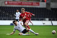 Lloyd Isgrove of Wales is tackled by England's Luke Garbutt (3). UEFA 2015 European U21 championship, group one qualifier , Wales u21 v England u21 at the Liberty Stadium in Swansea, South Wales on Monday 19th May 2014. <br /> pic by Andrew Orchard, Andrew Orchard sports photography.