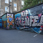 London, England, UK. 30th July 2017. A big letter of Grenfell graffiti art at Thorpe Close and the poster of missing person at Ladbroke Grove.