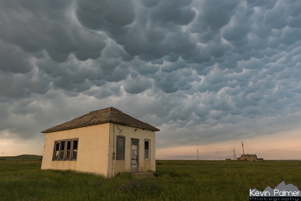 I love all the abandoned structures found in Eastern Montana. I came across this one while storm chasing outside of Ekalaka. Mammatus clouds were boiling above.